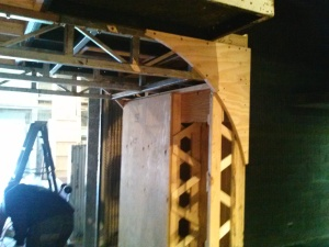 "...metal trusses sat atop the vertical wooden support trusses, which were then sheathed with 3/4"" ply."